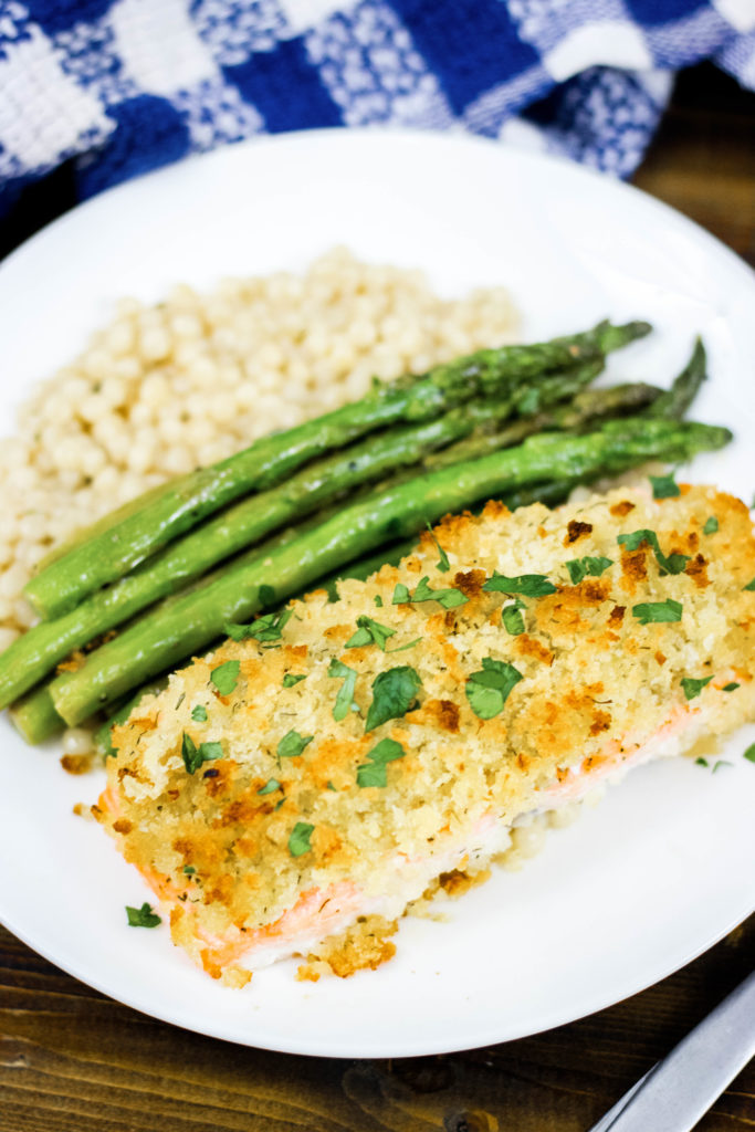 horseradish crusted salmon plated with asparagus and pearled couscous