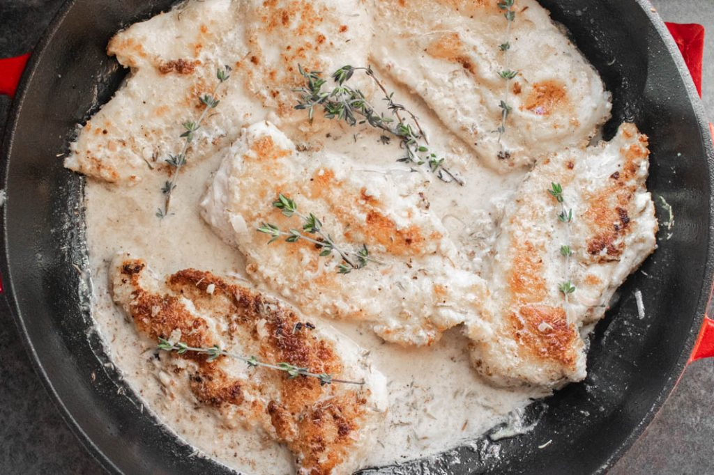 panko-crusted chicken in pan of white wine & thyme cream sauce