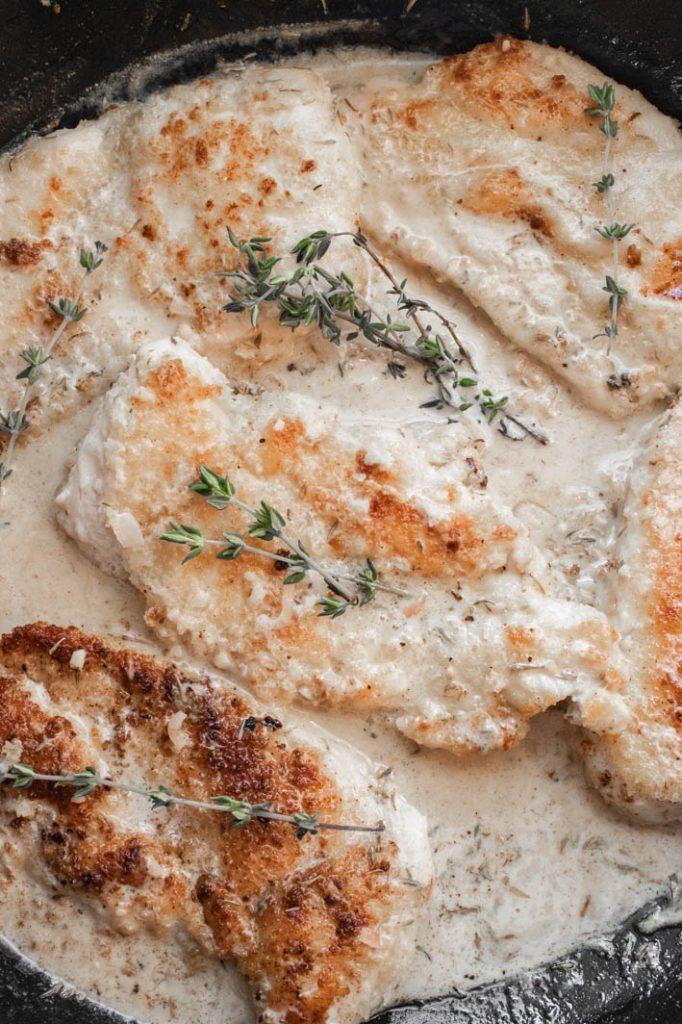 panko-crusted chicken in pan of white wine & thyme cream sauce
