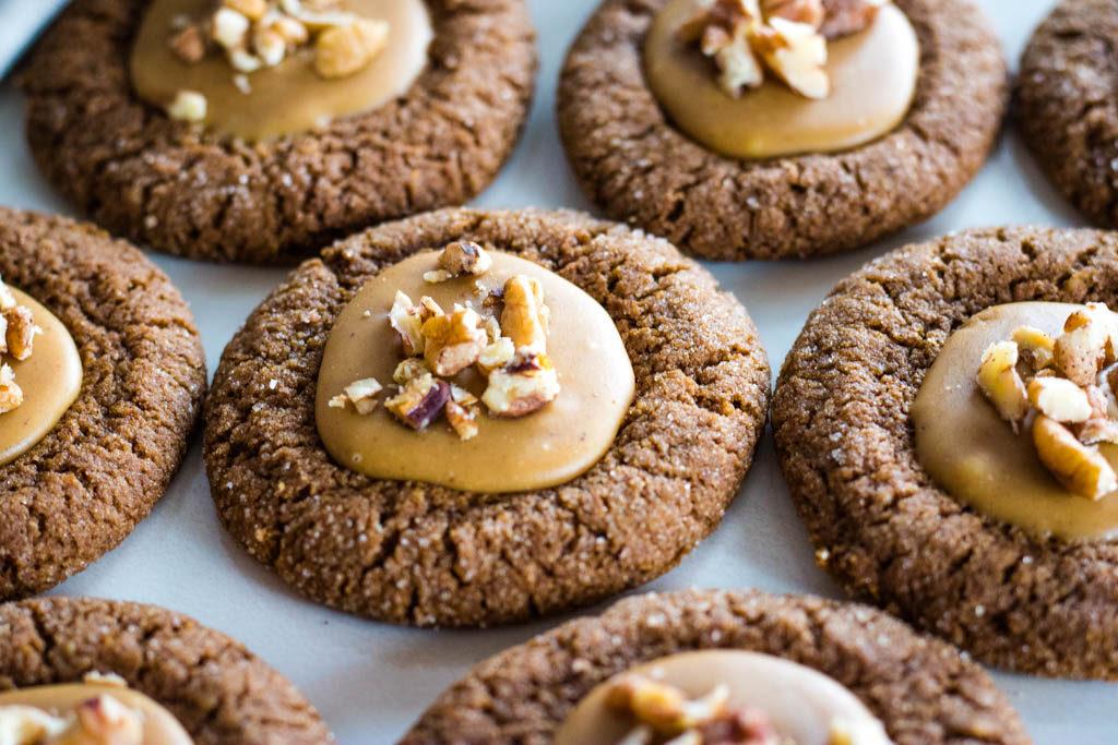 close up of pecan gingerbread thumbprint cookies