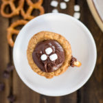 top view hot chocolate cookie cup with pretzels and miniature marshmallows