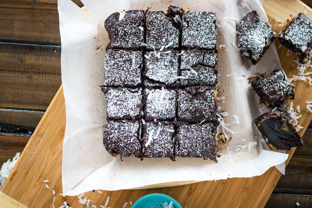 Top view of cut mounds brownies sprinkled with powdered sugar