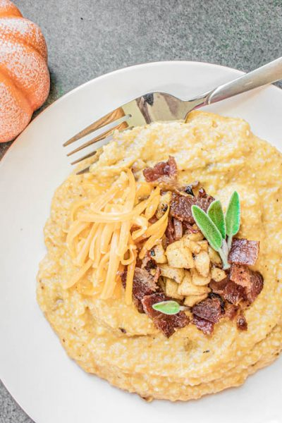 Pumpkin Cheddar Grits with Bacon & Apples